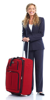 businesswoman traveler with red, wheeled suitcase