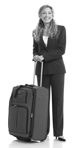 businesswoman traveler with wheeled suitcase